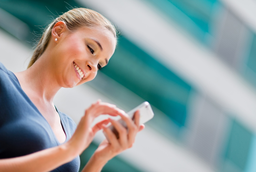 Business woman using app on a smart phone.jpeg
