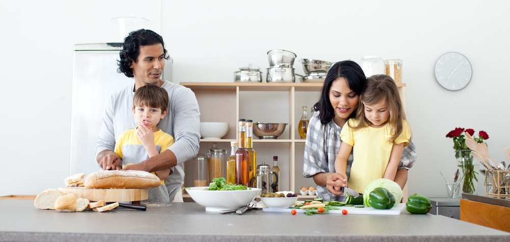 Portrait of a family preparing lunch in the kitchen.jpeg