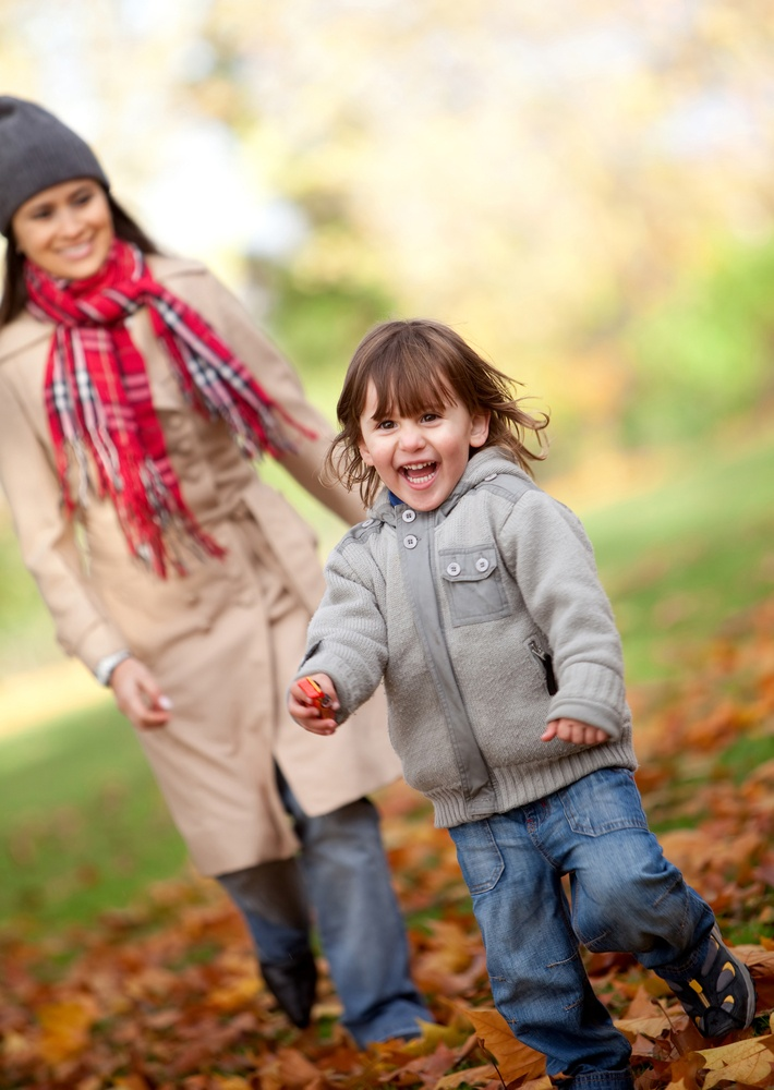 Mother and her son running at the park in autumn - family concepts.jpeg